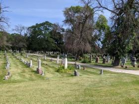 W. Lisbon Avenue passes Holy Cross Cemetery