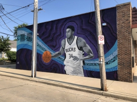 Giannis Antetokounmpo mural by Fred Kaems located at 3600 S. Clement Ave.