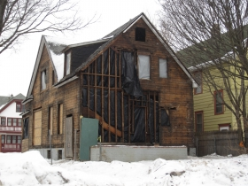 A fire damaged home in Milwaukee's Uptown neighborhood. The home was previously boarded up and is located at 2400 N 49th St. Home is city-owned. Photo by Jeramey Jannene.