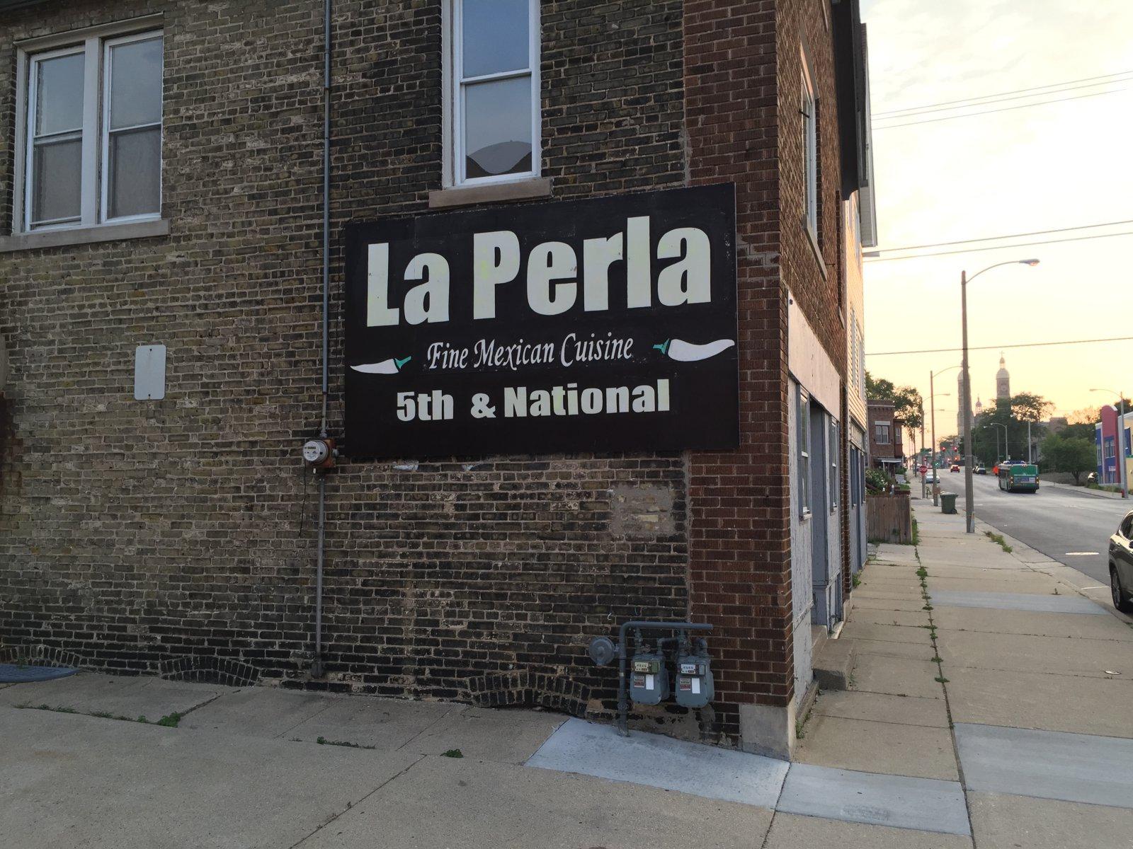 Sign for La Perla