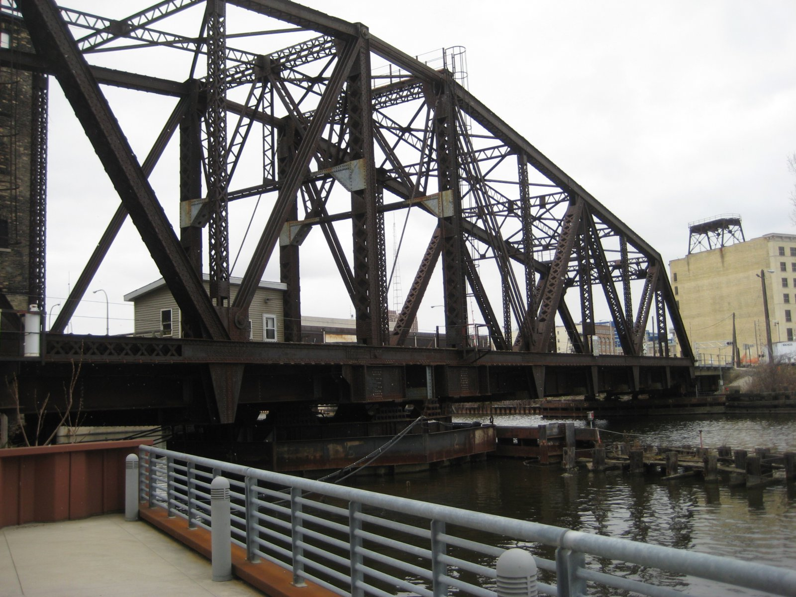 Train bridge next to The Point on the River.