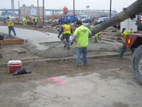 Pouring the cement for the new road.