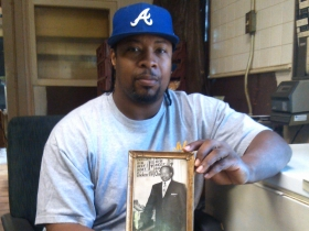 Darnell Ashley holds a photo of his father.