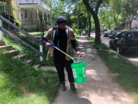 Vaun Mayes Picks Up Garbage