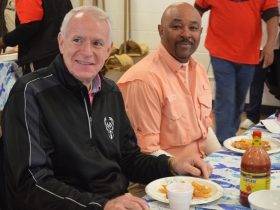 Mayor Tom Barrett and DNR Secretary-designee Preston Cole sample the freshly fried fish
