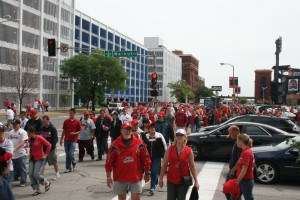 Fans take to the streets after games as the street grid distributes them across the city.  Cars are more confined to a lot of one way streets.