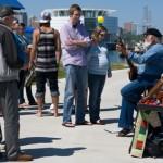 Crowd enjoys a folk song