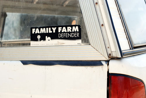 """Spotted on a farmer's truck in East Troy, Wis., this bumper sticker reads """"family farm defender."""" The farming industry is benefiting from more young entrepreneurs entering the field, thanks in large part to a growing national interest in the food system, and a desire to return to the earth. Photo by Liz Setterfield"""