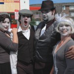 No, we're not mimes, we're silent movie comics!