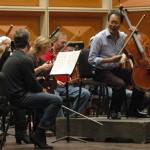 Yo-Yo Ma jokes with Concertmaster Frank Almond during a break in rehearsal