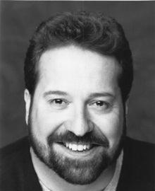 Bill Theisen, reinstated as artistic director through June, 2011.