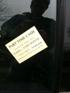 The soon-to-be-litter ad on a car window on the East Side.