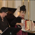Connie Grauer of Mrs. Fun looks on as Pluer plays the accordion