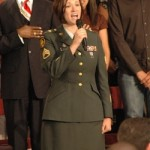 Staff Sergeant Emily Russell, of the Wisconsin National Guard sang the National Anthem before the President spoke.