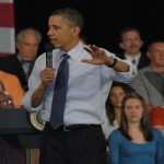 Obama rolled up his sleeves while taking questions from the crowd.