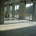 Seating space in the cafeteria, nice floor to ceiling windows.