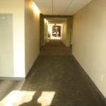 Welcoming hallway, unlike the prison-like atmosphere conveyed by some older buildings.