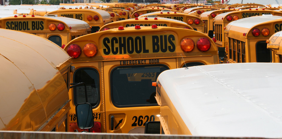School Buses. Photo by Jan-Erik Finnberg. Image trimmed (CC BY 2.0).