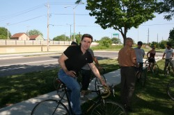 Alderman Zielinski posing with Alderman Kovac's bike.