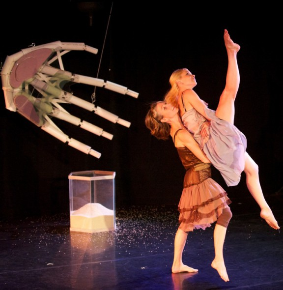 "Ott Thompson lifts Marquardt in ""Time's Present."" The hand and sand are nice, but we want to see Xander. Photo courtesy of Danceworks by Mark Frohna."