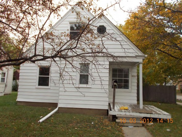 This house at 202 W. Hampton Ave. in Milwaukee is cited in the National Fair Housing Alliance discrimination complaint against Bank of America. According to the NFHA, there are 10 instances of poor maintenance or marketing practices at the Hampton Ave. address. (Photo by National Fair Housing Alliance)