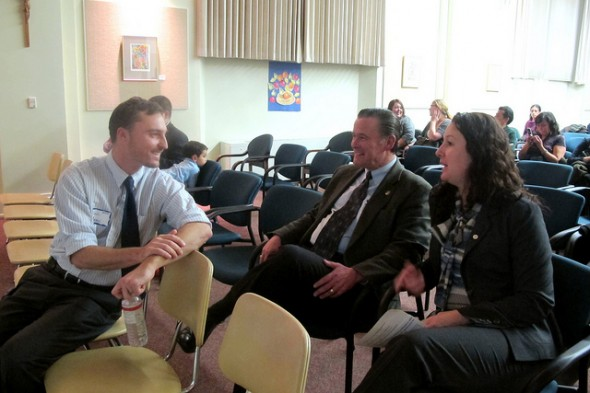Dan Adams, neighborhood plan coordinator for LBWN, chats with Alderman Robert G. Donovan and Marina Dimitrijevic, chairwoman of the Milwaukee County Board of Supervisors. Photo by Edgar Mendez, Milwaukee Neighborhood News Service