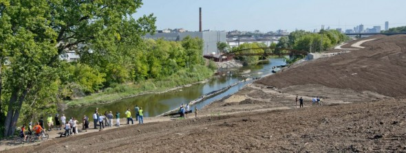 The view to the east of the 27th Street Viaduct showing the trails and park under construction. You can see the new bridge over the river just east of Palermo's Pizza.