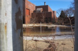 The wading pool adjacent to the building is full of brown murky water and shows various other signs of neglect. (Photo by Edgar Mendez)