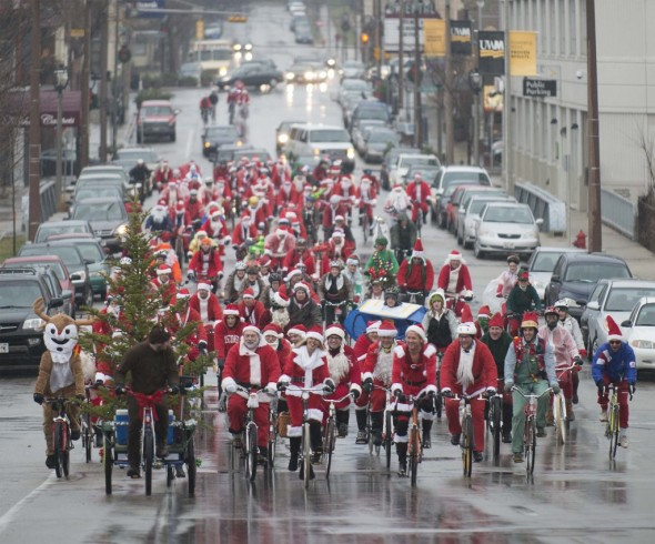 Even the gray, rainy weather couldn't dampen the holiday spirit. The group from Cafe Hollander on Downer rides down Farwell on their way to meet the rest of the holiday haymakers at Lakefront Brewery. Hundred's more rode in from other locations all around the Milwaukee area. See more photos on our Flickr Page, linked below.