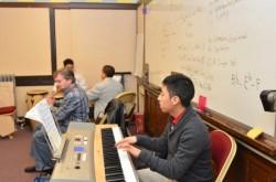 A student and teacher play a duet in a Carmen High School music class. (Photo by Sue Vliet)