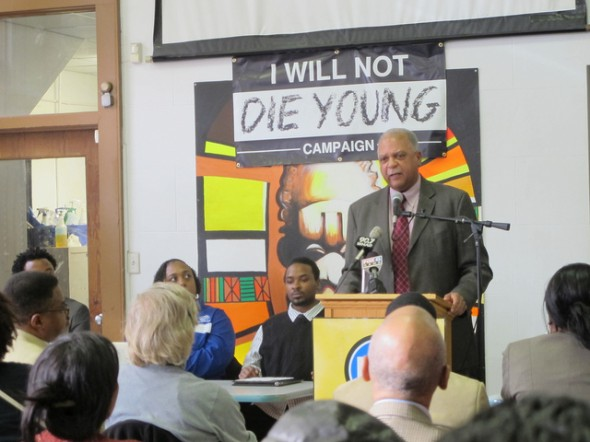 Superintendent Dr. Gregory Thornton speaks to a crowd about the importance of the Saving Our Sons — I Will Not Die Young campaign