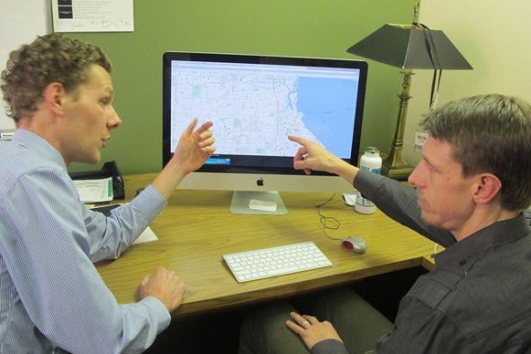 McGee Young and Nathan Conroy of Marquette discuss expansion strategies. (Photo by Edgar Mendez)
