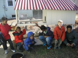 Neighborhood kids join Ben at the chicken coop. (Photo courtesy of Alex Runner)