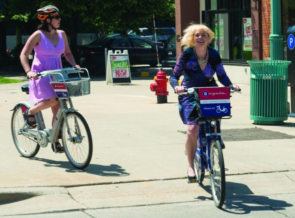 Beth Nichols, executive director of Milwaukee Downtown Business Improvement District, seems to be enjoying her ride on B-cycle at the Milwaukee Demo last year.