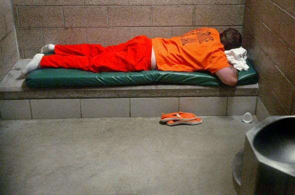 An inmate in the La Crosse County men's jail in 2006 has little to do but rest in his cell in a jail-issued uniform. Peter Thomson/La Crosse Tribune