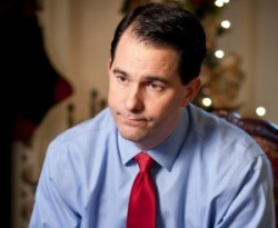 "In a Dec. 19 interview with the Wisconsin Center for Investigative Journalism, Gov. Scott Walker defended the tort reform law he proposed and lawmakers passed in January 2011, saying it was needed to forestall ""this constant pattern of litigation"" that could be seen as a negative by employers. Here Walker is pictured in December 2011. Lukas Keapproth/Wisconsin Center for Investigative Journalism"