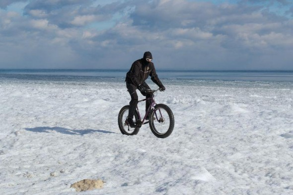 You don't have to dress like the famous Chris Zito rocking his fatbike on the shores of Lake Michigan at 2 degrees above zero. Photo by Greg Smith of Schlick Cycles
