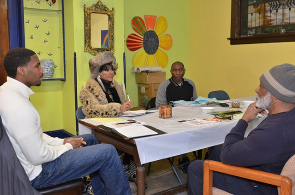 Members of the Borchert Field C.A.R.E.S. executive committee, (from left) Chairman Charles Robinson Jr., Brenda Nizer Jefferson, Acting Secretary Charles Robinson and Shadeed Shareef, discuss plans at the organization's new building at 831 W. Burleigh St. (Photo by Sue Vliet)