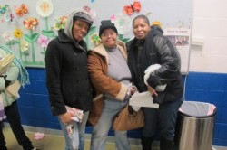 Ebony Pinkard, Terance Brown and Suzette Pinkard said the high cost of food is tough on families with limited budgets. (Photo by Edgar Mendez)