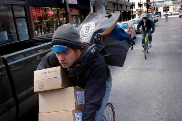 Breakaway alum Kevin Sparrow delivering a heavy load of cargo. Kevin now pedals around the arrondissements municipaux in Paris with his wife and daughter. Photo by Peter DiAntoni