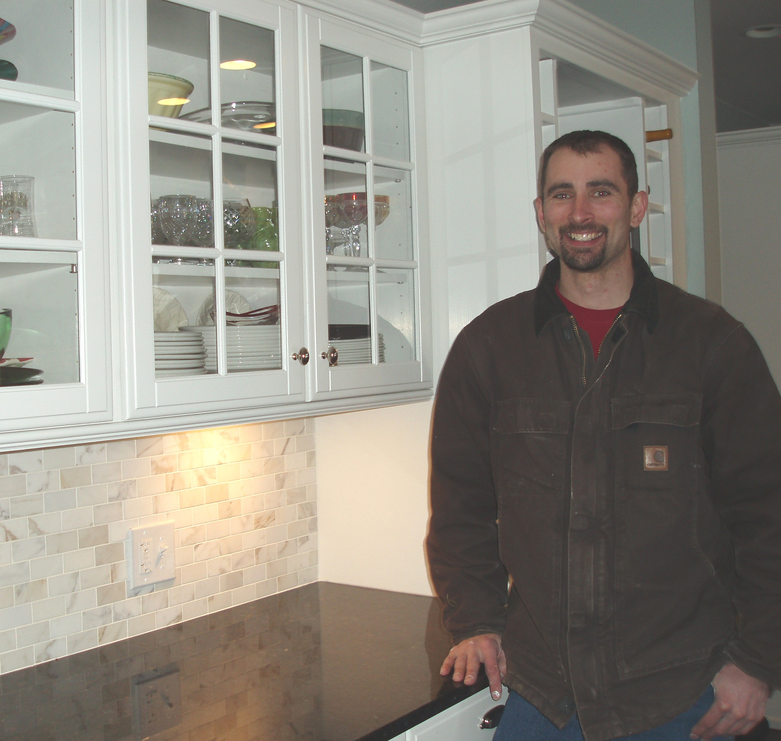 Joe Pollnow did the tile back splast and cabinetry in this kitchen. He's done numerous jobs in the same home for eight years. Photo by Peggy Schulz