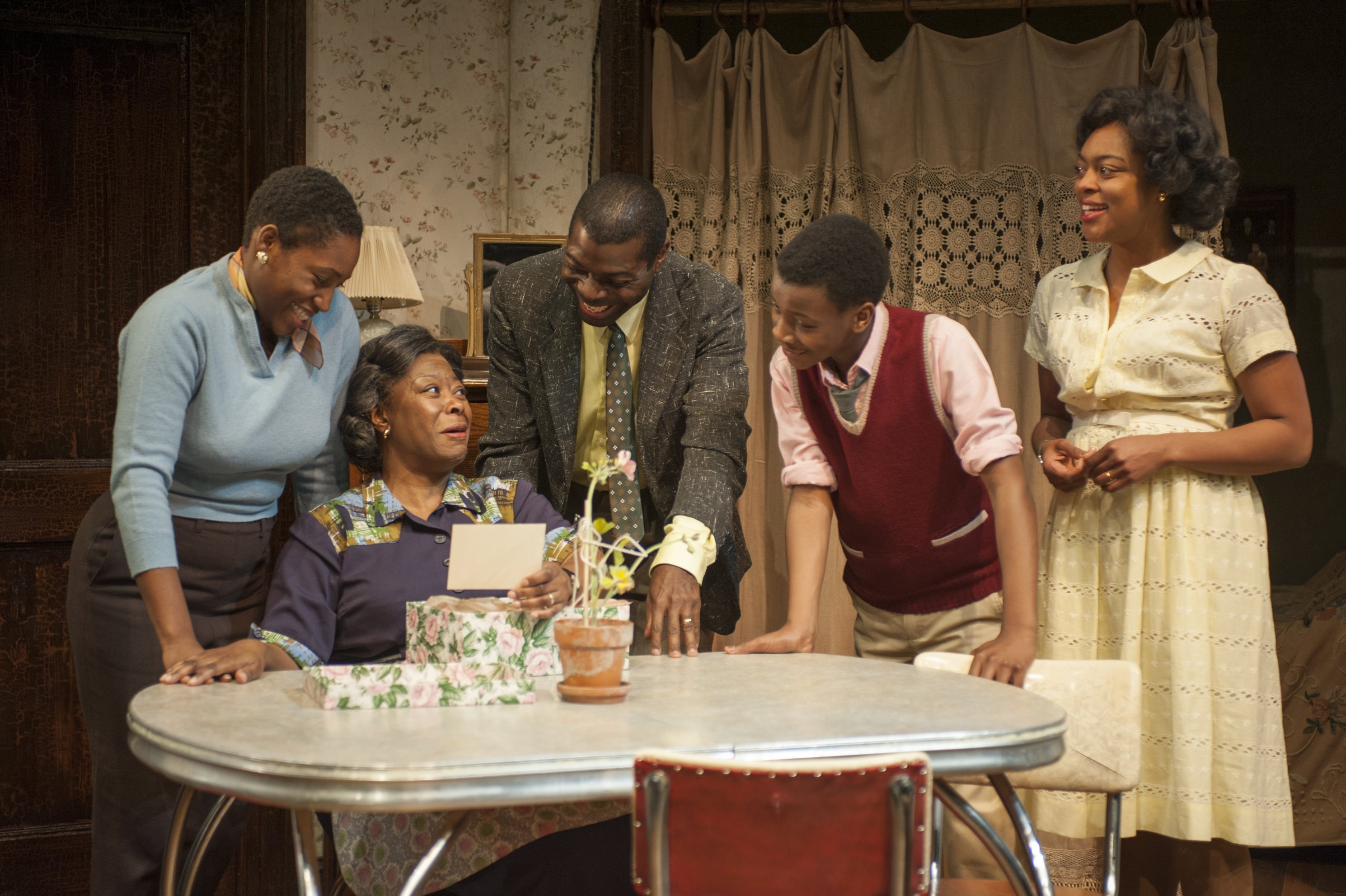 An analysis of the younger family in the play a raisin in the sun by lorraine hansberry