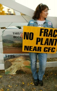 Shirley Evans of Modena, in Buffalo County, Wis., protests frac sand mining outside a sand industry conference in Minneapolis on Monday. Citizens concerned about the environmental impact of the mining industry have been reporting suspected violations to the DNR. Kate Golden/Wisconsin Center for Investigative Journalism