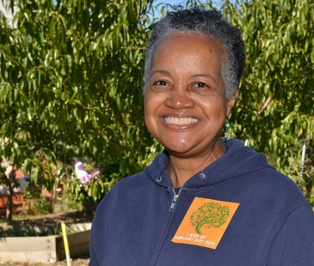 Sharon Adams, director of programs at Walnut Way Conservation Corp., says that though her organization doesn't have an official stance, she believes that city employees should find pleasure in living in the communities they serve. (Photo by Jen Janviere)