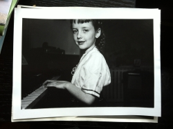 Young Frances playing the piano.