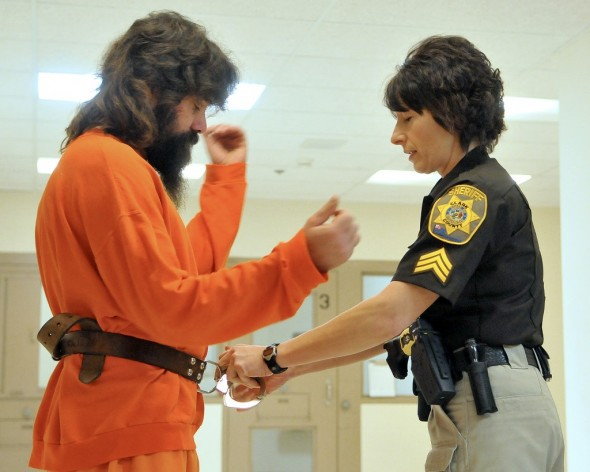 Sgt. Louise Hackel secures Clark County jail inmate John Unz prior to a sentencing hearing on April 8, 2013. Shane Opatz/Eau Claire Leader-Telegram.