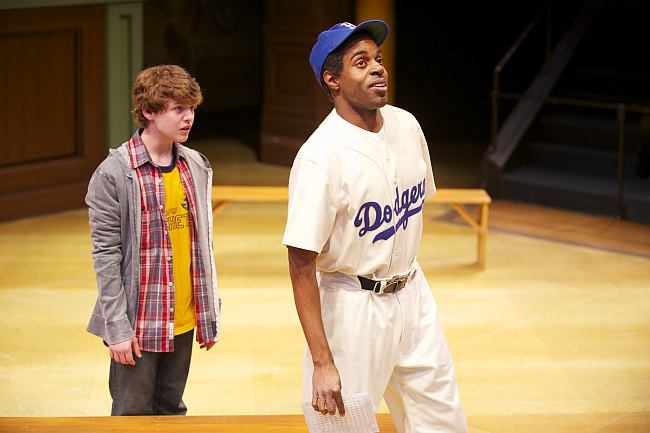 Seth Horne (L) plays Joey, a 21-century kid whose magical baseball card takes him back in time to visit Jackie Robinson (Chauncy Thomas). Photo credit Mark Frohna.