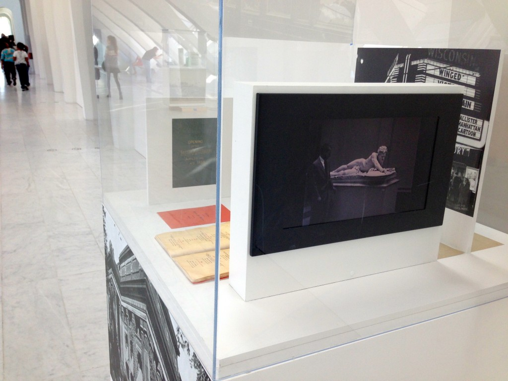 Archival video is shown on digital screens, and paired with printed materials to create a physical scrapbook of MAM's history.