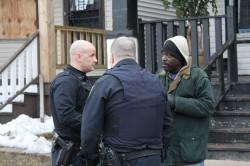 First stop, rousting a loiterer. Officer Matt Gadzalinski, left; Mike Miller, back to camera. Photo by Mark Doremus.