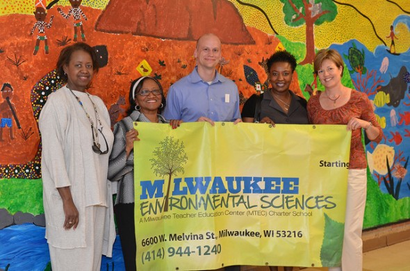 Sallie Brown, Rhulene Artis, Dave Libert, Alisia Moutry and Kirstin Anglea display the Milwaukee Environmental Sciences banner inside the new school. (Photo by Sue Vliet)